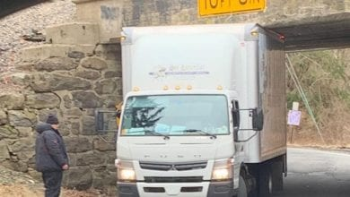 Photo of Truck driver ticketed after getting stuck in Grand Ave underpass