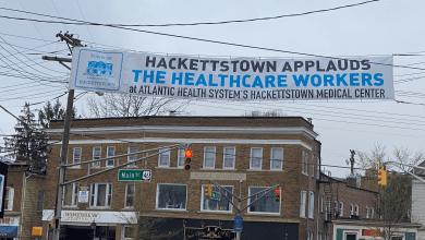 Photo of Hackettstown hangs banner to honor the healthcare workers at Hackettstown Medical Center