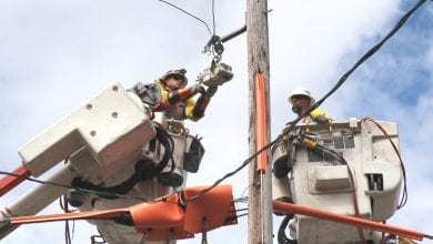Photo of Jersey Central Power & Light installing new automated devices to help reduce duration of power outages