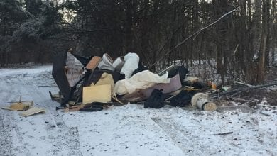 Photo of Park rangers investigating illegal dumping in Delaware Water Gap National Recreation Area
